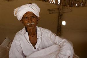 An elderly man in Pakistan, in his home, photo by Annie Griffiths